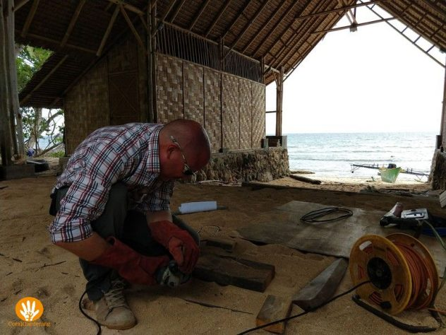 Frank working on our workplace with sea view