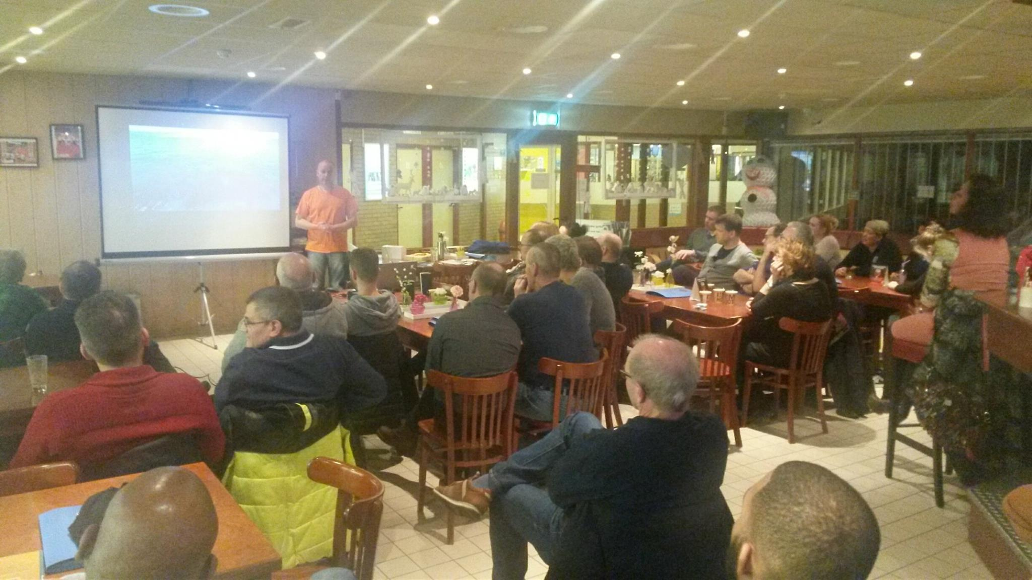 Frank gives a lecture at a diving club.