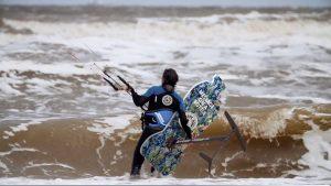 Merijn Tinga, the plastic soup surfer, in the waves.